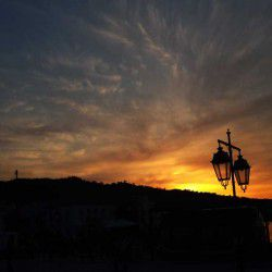 photo of sunset  at poseidonio square, One Million Words, travel & discover mysterious Greece