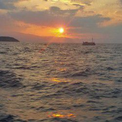 photo of sunset  from the caique, One Million Words, travel & discover mysterious Greece