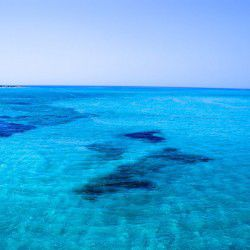 photo of crystalline water, Escapist State of Mind, travel & discover mysterious Greece
