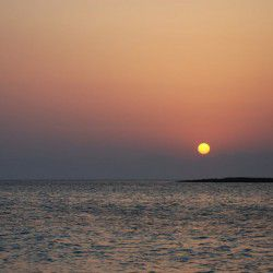 photo of sunset fromkatonisi, Escapist State of Mind, travel & discover mysterious Greece