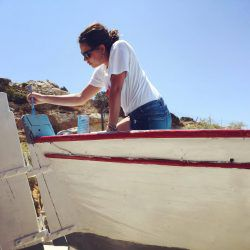 Christianna painting the boat © Christianna Economou