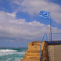 photo of greek flag, One Million Words, travel & discover mysterious Greece