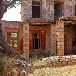 photo of red  house, Travel Experiences, travel & discover mysterious Greece